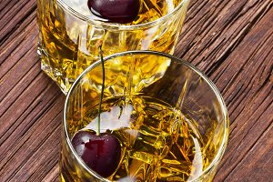 Cocktail from whisky with cherry
