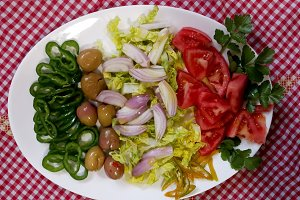 Fresh vegetable salad on tablecloth
