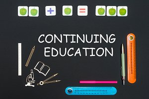Above stationery supplies and text continuing education on blackboard