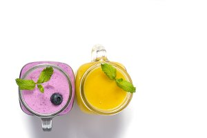 Purple and yellow smoothies