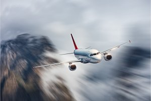 Airplane in motion. Aircraft with motion blur effect is flying i