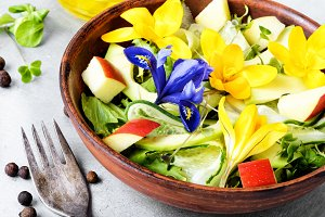 Fresh vegan salad with edible flower