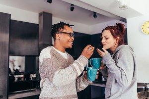 Interracial couple having coffee