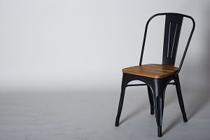 Steel with wood chair on Grey  textured background wall
