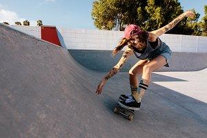 Woman practising skateboarding