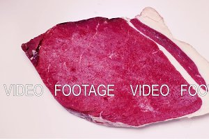 Time-laps frozen piece of meat
