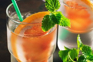 Refreshing cold cocktail with grapefruit and mint. Summer cold drink, detox.