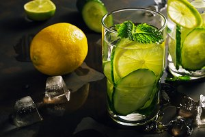 Water with cucumber, lemon and mint, detox. Refreshing drink in backlight.