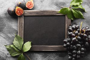 Black slate board and autumn harvest