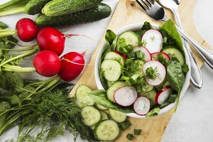 Salad with radish, cucumber, spinach