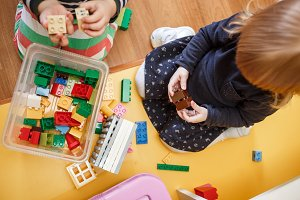 Children playing with blocks in the kindergarten