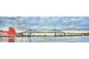 Panorama of Jacques Cartier Bridge crossing the Saint Lawrence River in Montreal, Canada