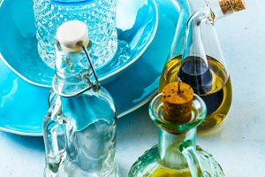 plates and glasses and  cruet with o