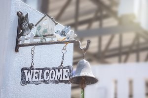 welcome sign hanging