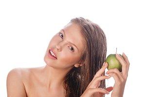 Teen girl holding green apple.