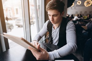 Young man with tablet pc computer at cafe