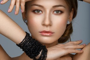 beautiful girl with many black bracelts