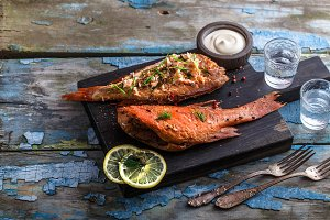 Smoked fish ocean perch with place for wording, copy space