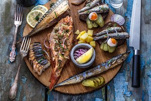 Fish plate with sturgeon, trout, perch, mackerel. Assorted fish on a plate