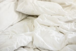 white pillow on bed and with wrinkle