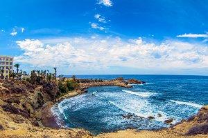Sea surface and rocky coastline