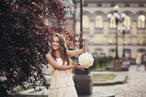 girl  holding a bouquet and smiling