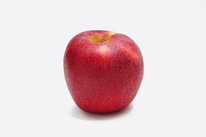 Red apple fruit on white background