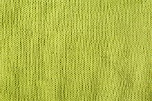 Green bright knitted texture background