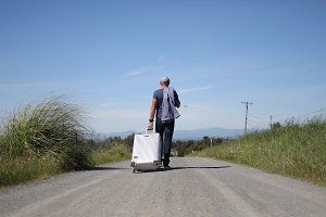 Man with Suitcase - Country Road