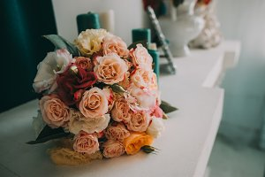Wedding flowers, bridal bouquet closeup. Decoration made of roses, peonies and decorative plants, close-up, selective focus