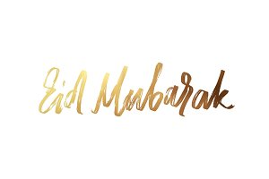 Eid mubarak. Text golden handwritten calligraphy.