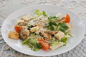Meat salad with vegetables and crout