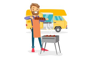 Young man barbecuing meat in front of camper van.