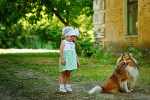 Little girl and dog for a walk.