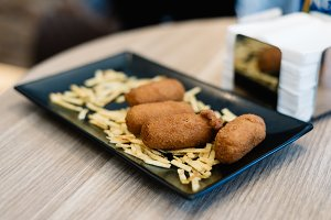 Close up of croquettes with potatoes