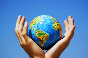 Earth globe in hands protected