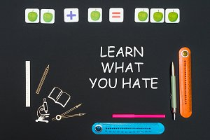 Above stationery supplies and text learn what you hate on blackboard