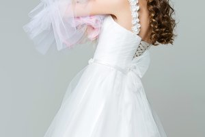 beautiful bride girl with spitz bride on gray background
