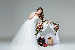bride girl with dog wedding couple under flower arch