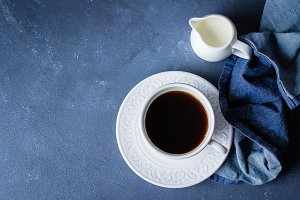 Cup of coffee and milk on blue stone
