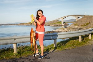 young woman with Norwegian fish