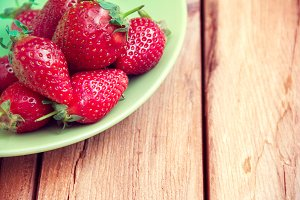strawberries on a green plate
