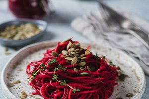 beetroot and thyme spaghetti with pumpkin seed