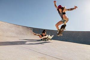 Female skaters doing stunts