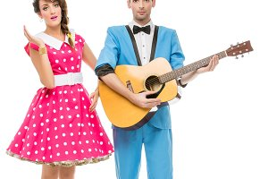 doll looking boy and girl with guitar