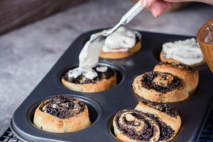 Cinnabon roll with poppy seeds on ba