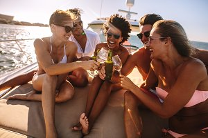 Friends having fun on a boat party