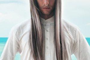 Handsome man in white shirt outdoor.