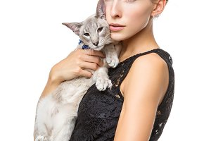 Beautiful girl with oriental siam cat