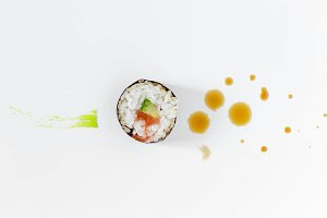 Sushi with splashes of soy sauce